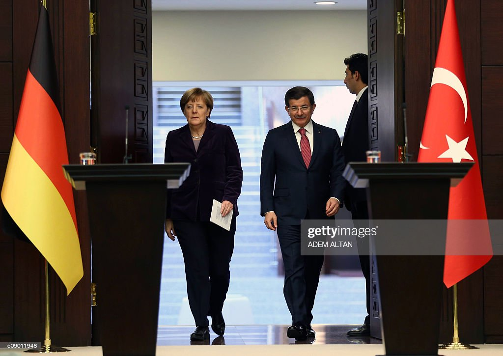 German Chancellor Angela Merkel (L) and Turkish Prime Minister Ahmet Davutoglu arrive for a joint press conference in Ankara on February 8, 2016. Turkey and Germany will ask NATO to help police the Turkish coast and stop traffickers from sending migrants on dangerous sea journeys, German Chancellor Angela Merkel said. ALTAN