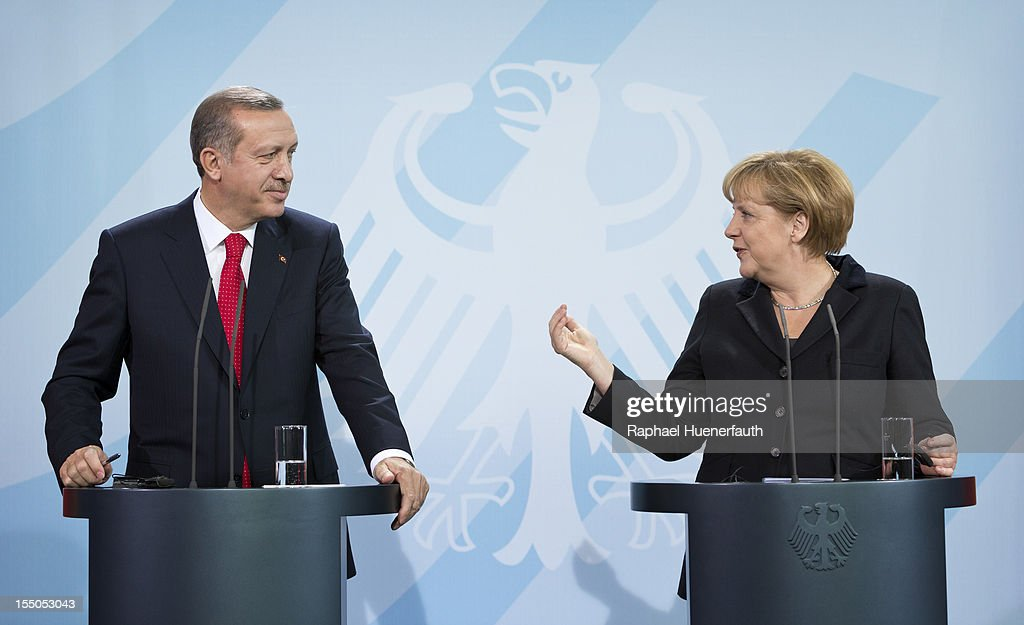 German Chancellor Angela Merkel (R) and Turkish Prime Minister Recep Tayyip Erdogan (L) hold a joint press conference on October 31, 2012 in Berlin, Germany. The two leaders held talks on bilateral relations, the crisis in Syria and Turkey's bid to join the European Union. Erdogan also attended the opening of a new Turkish embassy after his arrival on Tuesday.