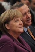German Chancellor Angela Merkel and Turkish Prime Minister Recep Tayyip Erdogan arrive for a celebraition to mark 50 years of Turkish immigration to...