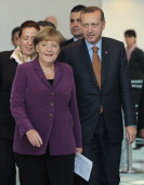 German Chancellor Angela Merkel and Turkish Prime Minister Recep Tayyip Erdogan arrive to speak to the media after talks at the Chancellery on...