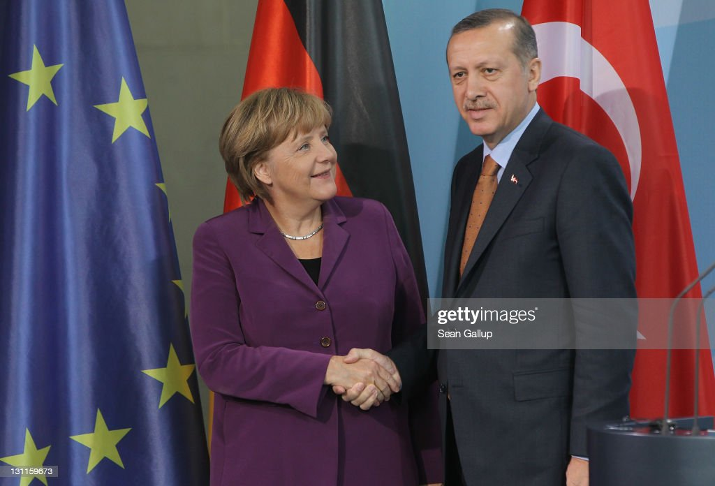 German Chancellor Angela Merkel and Turkish Prime Minister Recep Tayyip Erdogan shake hands after speaking to the media following talks at the...