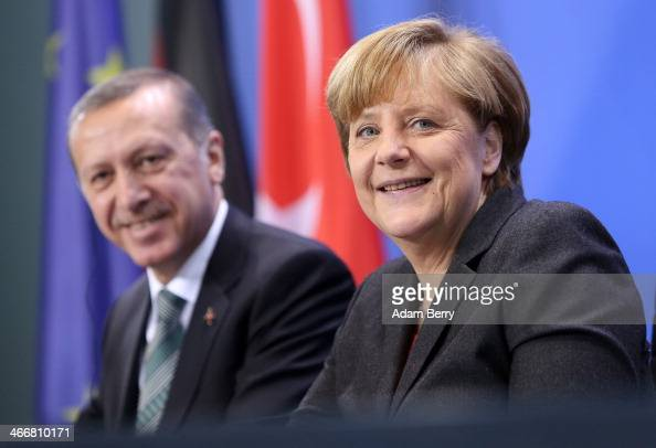 German Chancellor Angela Merkel and Turkish Prime Minister Recep Tayyip Erdogan speak to the media following talks at the German federal Chancellery...