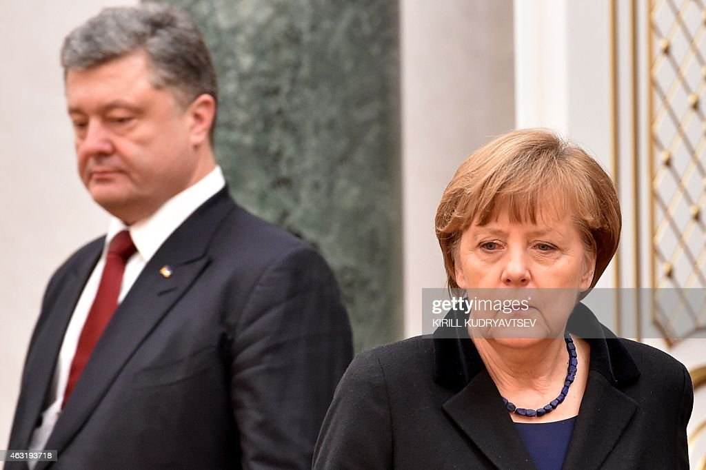 German Chancellor Angela Merkel and Ukraine's President Petro Poroshenko attend a meeting on February 11 2015 in Minsk aimed at halting a 10month war...