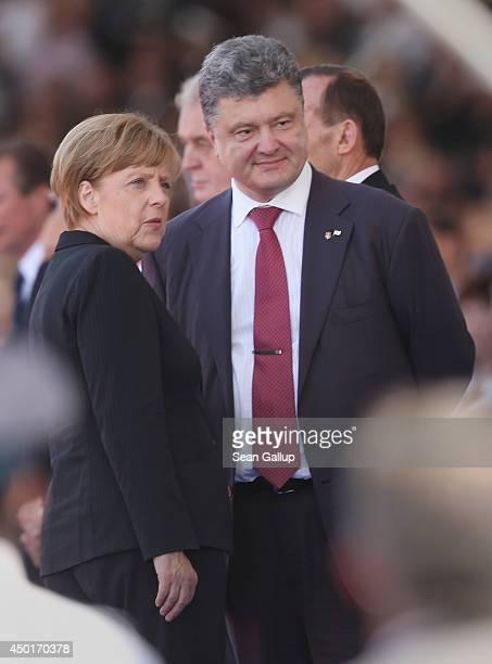 German Chancellor Angela Merkel and Ukrainian President Petro Poroshenko attend the main international ceremony commemorating the 70th anniversary of...