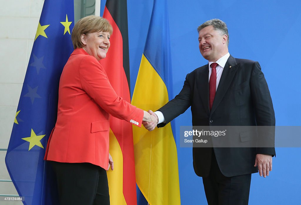 German Chancellor Angela Merkel and Ukrainian President Petro Poroshenko depart after giving statements to the media prior to talks at the Chancellery on May 13, 2015 in Berlin, Germany. The two leaders are meeting on the heels of a meeting between Russian President Vladimir Putin and U.S. Secretary of State John Kerry the day before in ongoing talks over the confict in the Donbas region of eastern Ukraine.