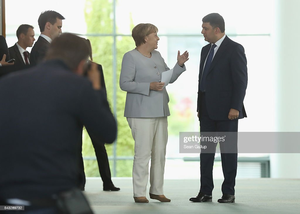 German Chancellor <a gi-track='captionPersonalityLinkClicked' href=/galleries/search?phrase=Angela+Merkel&family=editorial&specificpeople=202161 ng-click='$event.stopPropagation()'>Angela Merkel</a> and Ukrainian Prime Minister <a gi-track='captionPersonalityLinkClicked' href=/galleries/search?phrase=Volodymyr+Groysman&family=editorial&specificpeople=12954124 ng-click='$event.stopPropagation()'>Volodymyr Groysman</a> arrive to speak to the media following talks at the Chancellery on June 27, 2016 in Berlin, Germany. Groysman is on his first official visit to Germany since he took office.