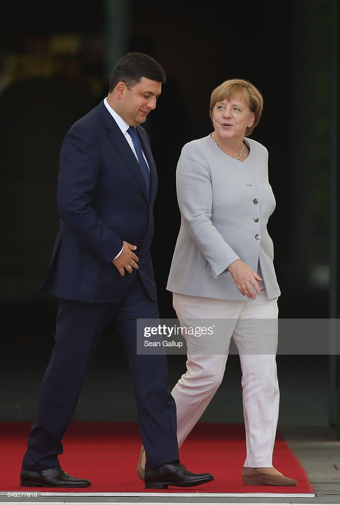 German Chancellor <a gi-track='captionPersonalityLinkClicked' href=/galleries/search?phrase=Angela+Merkel&family=editorial&specificpeople=202161 ng-click='$event.stopPropagation()'>Angela Merkel</a> and Ukrainian Prime Minister <a gi-track='captionPersonalityLinkClicked' href=/galleries/search?phrase=Volodymyr+Groysman&family=editorial&specificpeople=12954124 ng-click='$event.stopPropagation()'>Volodymyr Groysman</a> chat upon Groysman's arrival at the Chancellery on June 27, 2016 in Berlin, Germany. Groysman is on his first official visit to Germany since he took office.
