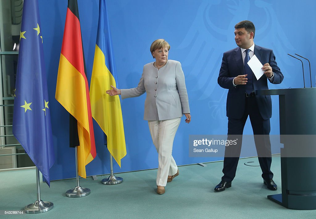 German Chancellor <a gi-track='captionPersonalityLinkClicked' href=/galleries/search?phrase=Angela+Merkel&family=editorial&specificpeople=202161 ng-click='$event.stopPropagation()'>Angela Merkel</a> and Ukrainian Prime Minister <a gi-track='captionPersonalityLinkClicked' href=/galleries/search?phrase=Volodymyr+Groysman&family=editorial&specificpeople=12954124 ng-click='$event.stopPropagation()'>Volodymyr Groysman</a> depart after speaking to the media following talks at the Chancellery on June 27, 2016 in Berlin, Germany. Groysman is on his first official visit to Germany since he took office.