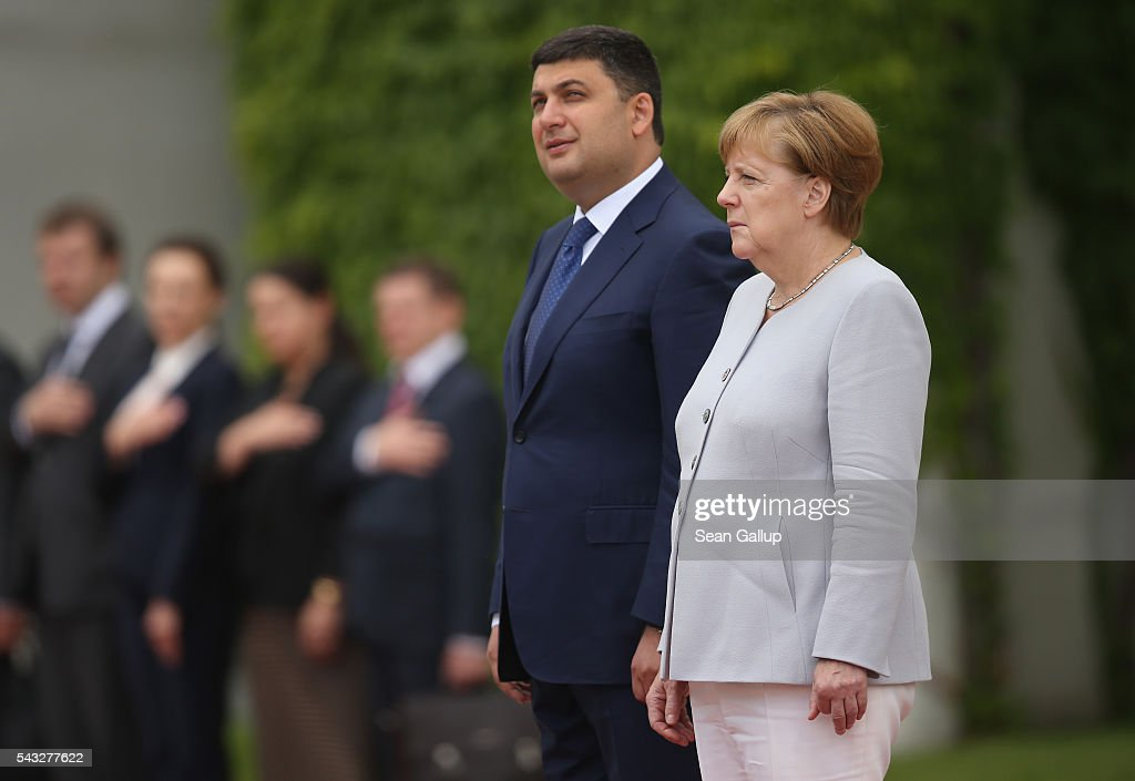 German Chancellor <a gi-track='captionPersonalityLinkClicked' href=/galleries/search?phrase=Angela+Merkel&family=editorial&specificpeople=202161 ng-click='$event.stopPropagation()'>Angela Merkel</a> and Ukrainian Prime Minister <a gi-track='captionPersonalityLinkClicked' href=/galleries/search?phrase=Volodymyr+Groysman&family=editorial&specificpeople=12954124 ng-click='$event.stopPropagation()'>Volodymyr Groysman</a> listen to their countries' respectie naitonal anthems upon Groysman's arrival at the Chancellery on June 27, 2016 in Berlin, Germany. Groisman is on his first official visit to Germany since he took office.