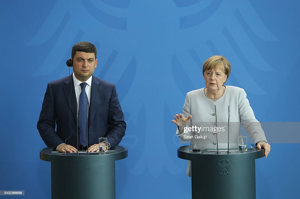 German Chancellor <a gi-track='captionPersonalityLinkClicked' href=/galleries/search?phrase=Angela+Merkel&family=editorial&specificpeople=202161 ng-click='$event.stopPropagation()'>Angela Merkel</a> and Ukrainian Prime Minister <a gi-track='captionPersonalityLinkClicked' href=/galleries/search?phrase=Volodymyr+Groysman&family=editorial&specificpeople=12954124 ng-click='$event.stopPropagation()'>Volodymyr Groysman</a> speak to the media after talks at the Chancellery on June 27, 2016 in Berlin, Germany. Groysman is on his first official visit to Germany since he took office.