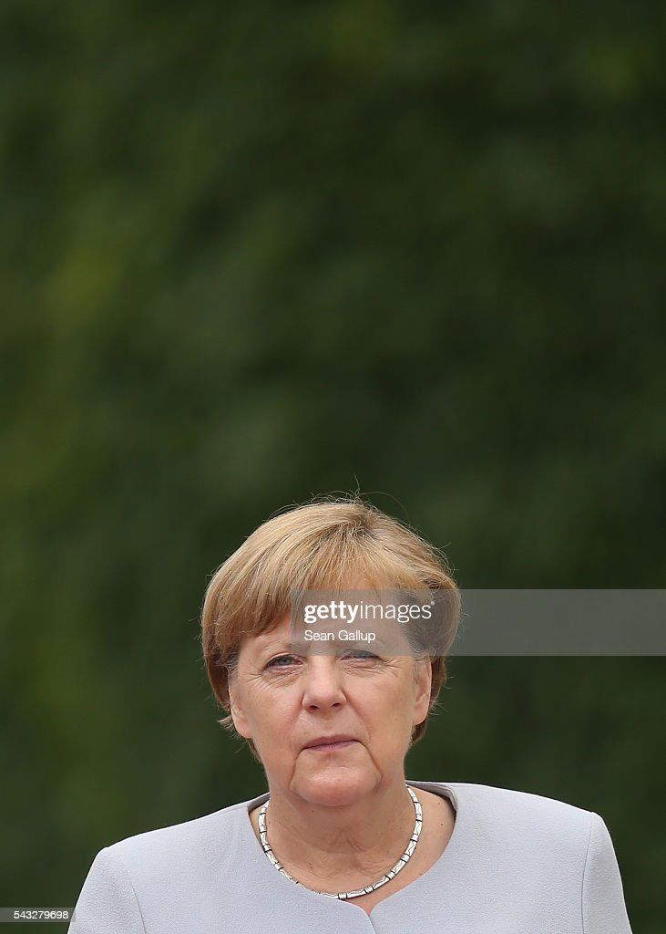 German Chancellor <a gi-track='captionPersonalityLinkClicked' href=/galleries/search?phrase=Angela+Merkel&family=editorial&specificpeople=202161 ng-click='$event.stopPropagation()'>Angela Merkel</a> and Ukrainian Prime Minister Volodymyr Groysman (not pictured) prepare to listen to their countries' national anthems upon Groysman's arrival at the Chancellery on June 27, 2016 in Berlin, Germany. Merkel is scheduled to receive French President Francois Hollande, Italian Prime Minister Matteo Renzi and European Council President Donald Tusk later today to discuss the consequences of last week's Brexit vote.