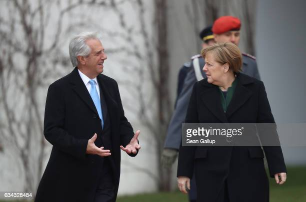 German Chancellor Angela Merkel and Uruguayan President Tabare Vazquez chat upon Vazquez's arrival at the Chancellery on February 8 2017 in Berlin...