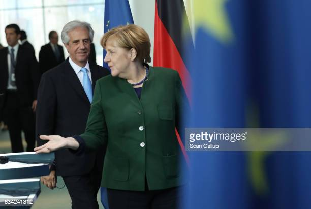 German Chancellor Angela Merkel and Uruguayan President Tabare Vazquez arrive to speak to the media following talks at the Chancellery on February 8...
