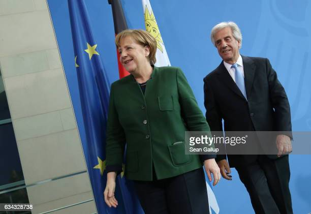 German Chancellor Angela Merkel and Uruguayan President Tabare Vazquez depart after speaking to the media following talks at the Chancellery on...