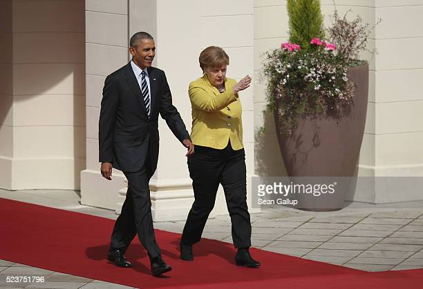 German Chancellor Angela Merkel and US President Barack Obama emerge from Schloss Herrenhausen palace upon Obama's arrival on April 24 2016 in...