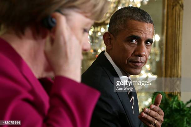 German Chancellor Angela Merkel and US President Barack Obama hold a joint news conference in the East Room after meetings about the situation in...