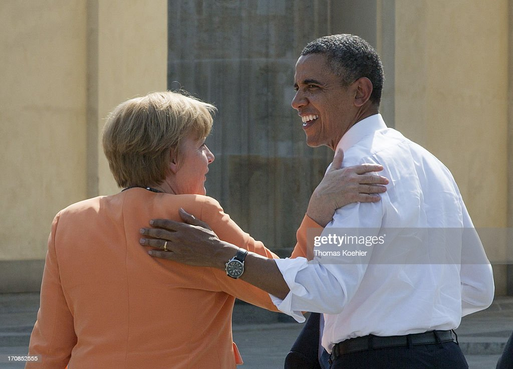 German Chancellor <a gi-track='captionPersonalityLinkClicked' href=/galleries/search?phrase=Angela+Merkel&family=editorial&specificpeople=202161 ng-click='$event.stopPropagation()'>Angela Merkel</a> and U.S. President <a gi-track='captionPersonalityLinkClicked' href=/galleries/search?phrase=Barack+Obama&family=editorial&specificpeople=203260 ng-click='$event.stopPropagation()'>Barack Obama</a> hug after Obama gave a speech in front of Berlin's landmark the Brandenburg Gate near the US embassy on June 19, 2013 in Berlin, Germany. Obama is set to speak on the east side of the Brandenburg Gate, 50 years after John F. Kennedy famously declared his solidarity with the citizens of Berlin.