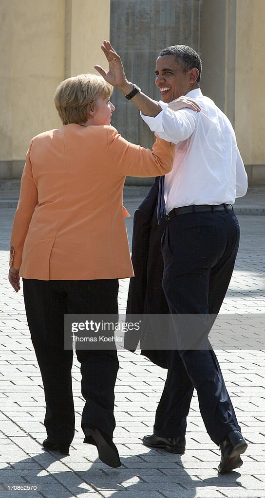 German Chancellor <a gi-track='captionPersonalityLinkClicked' href=/galleries/search?phrase=Angela+Merkel&family=editorial&specificpeople=202161 ng-click='$event.stopPropagation()'>Angela Merkel</a> and US President <a gi-track='captionPersonalityLinkClicked' href=/galleries/search?phrase=Barack+Obama&family=editorial&specificpeople=203260 ng-click='$event.stopPropagation()'>Barack Obama</a> hug after Obama gave a speech in front of Berlin's landmark the Brandenburg Gate near the US embassy on June 19, 2013 in Berlin, Germany. Obama is set to speak on the east side of the Brandenburg Gate, 50 years after John F. Kennedy famously declared his solidarity with the citizens of Berlin.