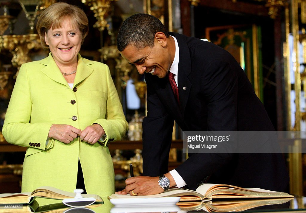 German Chancellor <a gi-track='captionPersonalityLinkClicked' href=/galleries/search?phrase=Angela+Merkel&family=editorial&specificpeople=202161 ng-click='$event.stopPropagation()'>Angela Merkel</a> (L) and U.S. President <a gi-track='captionPersonalityLinkClicked' href=/galleries/search?phrase=Barack+Obama&family=editorial&specificpeople=203260 ng-click='$event.stopPropagation()'>Barack Obama</a> sign in a golden book in the 'Gruenes Gewoelbe' (Green Vault) on June 5, 2009 in Dresden, Germany. Obama will visit Buchenwald, a former Nazi concentration camp, later today.