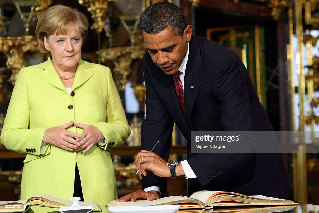 German Chancellor <a gi-track='captionPersonalityLinkClicked' href=/galleries/search?phrase=Angela+Merkel&family=editorial&specificpeople=202161 ng-click='$event.stopPropagation()'>Angela Merkel</a> (L) and U.S. President <a gi-track='captionPersonalityLinkClicked' href=/galleries/search?phrase=Barack+Obama&family=editorial&specificpeople=203260 ng-click='$event.stopPropagation()'>Barack Obama</a> sign in a golden book in the 'Historical Gruenes Gewoelbe' (Green Vault) on June 5, 2009 in Dresden, Germany. Obama will visit Buchenwald, a former Nazi concentration camp, later today.
