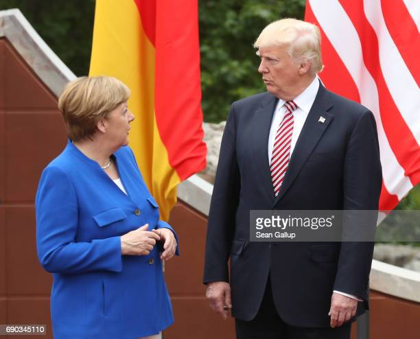 German Chancellor Angela Merkel and US President Donald Trump arrive for the group photo at the G7 Taormina summit on the island of Sicily on May 26...