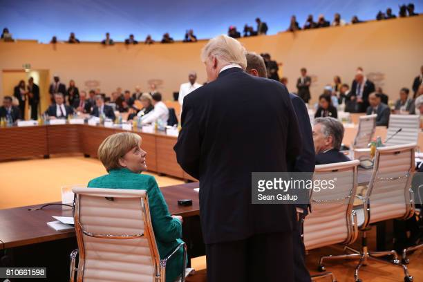 German Chancellor Angela Merkel and US President Donald Trump chat prior to the morning working session on the second day of the G20 economic summit...