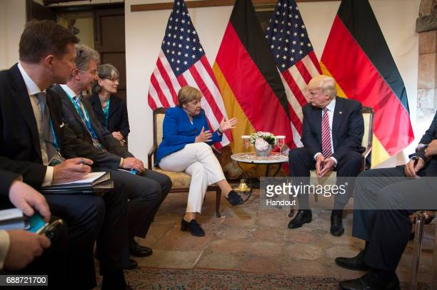 German Chancellor Angela Merkel and US President Donald Trump meet at the start of the G7 summit on May 26 2017 in Taormina Italy President Trump and...