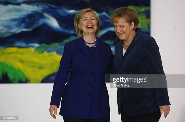 German Chancellor Angela Merkel and US Secretary of State Hillary Clinton arrive to give statements to the media at the Chancellery on November 9...