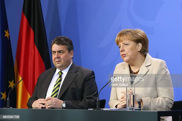 German Chancellor Angela Merkel and Vice Chancellor and Economy and Energy Minister Sigmar Gabriel speak to journalists following two days of...