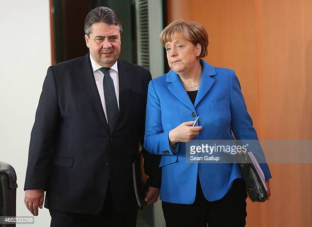 German Chancellor Angela Merkel and Vice Chancellor and Economy and Energy Minister Sigmar Gabriel arrive for the weekly German government cabinet...