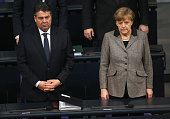 German Chancellor Angela Merkel and Vice Chancellor and Economy and Energy Minister Sigmar Gabriel observe a moment of slience prior to a plenary...
