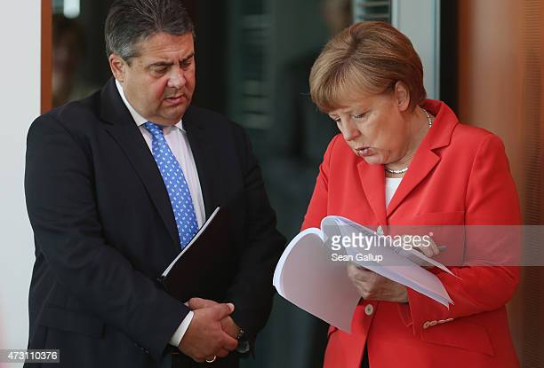 German Chancellor Angela Merkel and Vice Chancellor and Economy and Energy Minister Sigmar Gabriel look at an unidentified document prior to the...