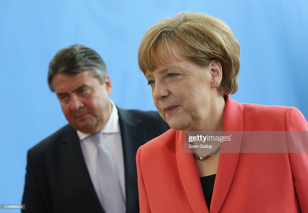 German Chancellor Angela Merkel and Vice Chancellor and Economy and Energy Minister Sigmar Gabriel depart after they spoke to the media following an extraordinary meeting with leaders of Germany's main political parties at the Chancellery the day after the European Central Bank announced it would not extend emergency funding to Greece on June 29, 2015 in Berlin, Germany. Stock markets in Europe were markedly down today and the Greek government ordered cash machines turned off and a tightening on the flow of capital in an effort to staunch citizens' withdrawals.