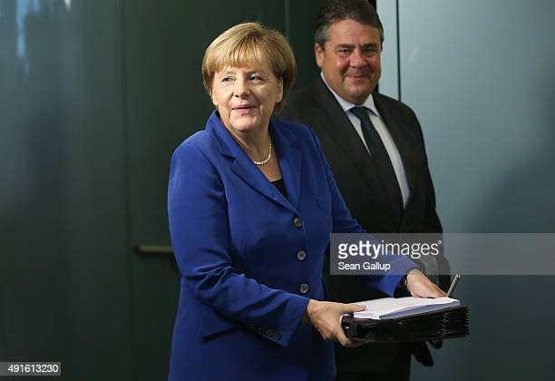 German Chancellor Angela Merkel and Vice Chancellor and Economy and Energy Minister Sigmar Gabriel arrive for the weekly government cabinet meeting...