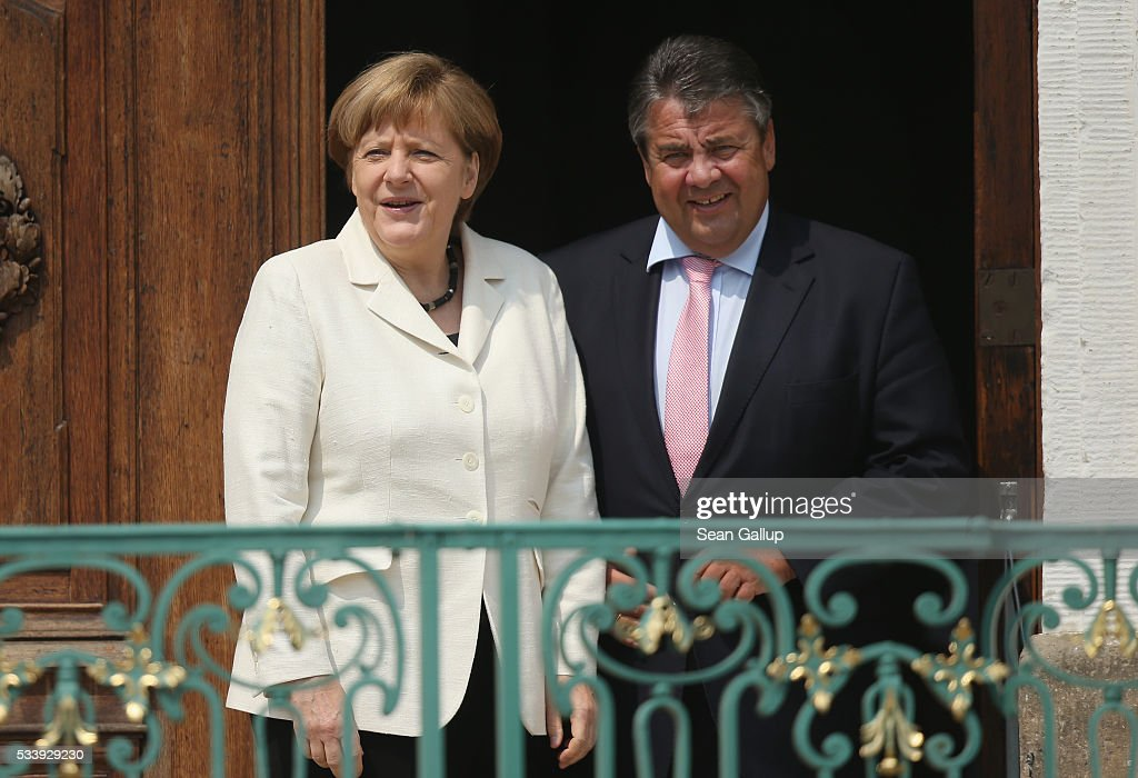 German Chancellor Angela Merkel and Vice Chancellor and Economy and Energy Minister Sigmar Gabriel arrive for a meeting of the German government cabinet together with European Commissioner for Energy in the European Commission Guenther Oettinger at Schloss Meseberg palace on May 24, 2016 in Gransee, Germany. The government cabinet is meeting at Schloss Meseberg for a two-day retreat.
