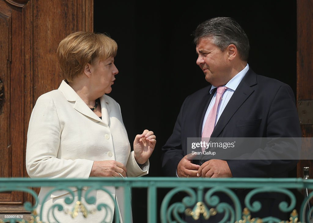 German Chancellor Angela Merkel and Vice Chancellor and Economy and Energy Minister Sigmar Gabriel arrive for a meeting of the German government cabinet together with European Commissioner for Digital Economy and Society Guenther Oettinger at Schloss Meseberg palace on May 24, 2016 in Gransee, Germany. The government cabinet is meeting at Schloss Meseberg for a two-day retreat.