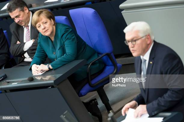 German Chancellor Angela Merkel and Vice Chancellor and Foreign Minister Sigmar Gabriel listen to new German President FrankWalter Steinmeier as he...