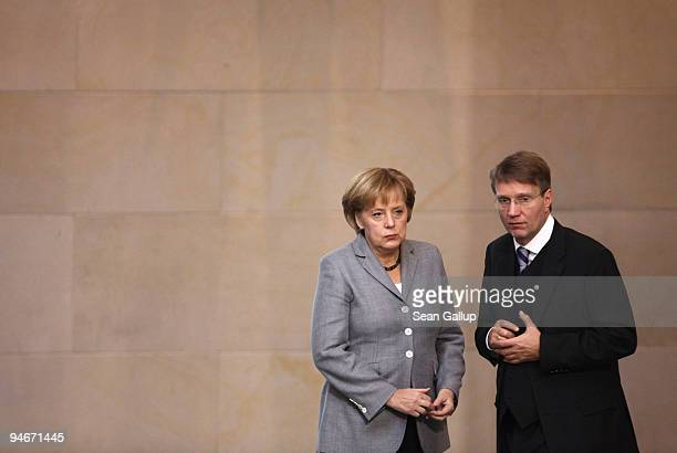 German Chancellor Angela Merkel and Vice Chancellor and Minister of the Chancellery Ronald Pofalla chat after Merkel gave a government declaration on...