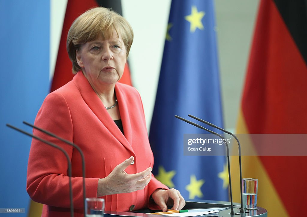 German Chancellor Angela Merkel and Vice Chancellor speaks to the media following an extraordinary meeting with leaders of Germany's main political parties at the Chancellery the day after the European Central Bank announced it would not extend emergency funding to Greece on June 29, 2015 in Berlin, Germany. Stock markets in Europe were markedly down today and the Greek government ordered cash machines turned off and a tightening on the flow of capital in an effort to staunch citizens' withdrawals.