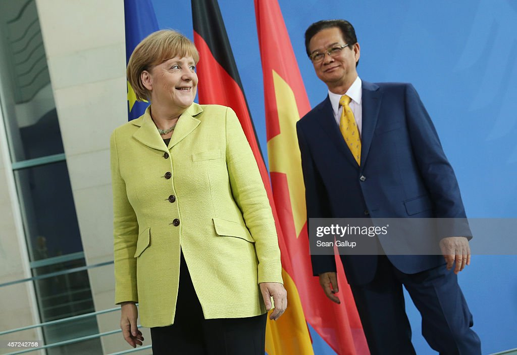 German Chancellor <a gi-track='captionPersonalityLinkClicked' href=/galleries/search?phrase=Angela+Merkel&family=editorial&specificpeople=202161 ng-click='$event.stopPropagation()'>Angela Merkel</a> and Vietnamese Prime Minister <a gi-track='captionPersonalityLinkClicked' href=/galleries/search?phrase=Nguyen+Tan+Dung&family=editorial&specificpeople=544511 ng-click='$event.stopPropagation()'>Nguyen Tan Dung</a> depart after speaking to the media following talks at the Chancellery on October 15, 2014 in Berlin, Germany. The two leaders discussed, among other topics, the current tensions between China, Vietnam and the Philippines over access to the South China Sea sea lanes.