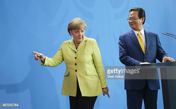 German Chancellor Angela Merkel and Vietnamese Prime Minister Nguyen Tan Dung depart after speaking to the media following talks at the Chancellery...