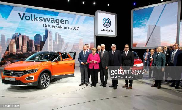 German Chancellor Angela Merkel and Volkswagen CEO Matthias Mueller the president of the German Automobile Industry Association Matthias Wissmann...