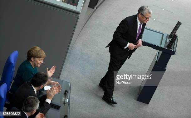 German Chancellor Angela Merkel applaudes after the speech of former German President Joachim Gauck before the swearingin ceremony of new German...