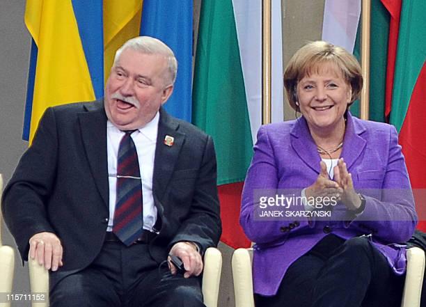 German Chancellor Angela Merkel applauds next to former Polish President Lech Walesa the iconic Solidarity union leaderon June 4 2009 during...