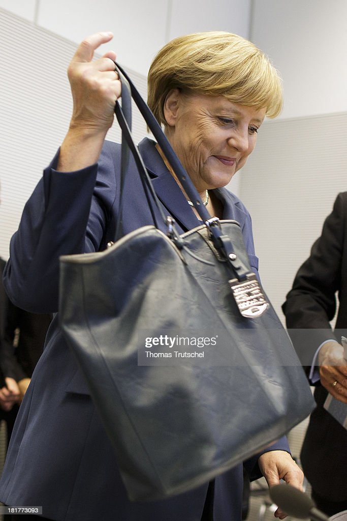 German Chancellor <a gi-track='captionPersonalityLinkClicked' href=/galleries/search?phrase=Angela+Merkel&family=editorial&specificpeople=202161 ng-click='$event.stopPropagation()'>Angela Merkel</a> (CDU) arrive for a CDU/CSU parliamentary group's meeting at the lower house of parliament Bundestag on September 24, 2013 in Berlin, Germany.