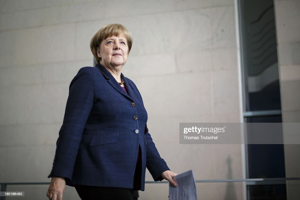 German Chancellor <a gi-track='captionPersonalityLinkClicked' href=/galleries/search?phrase=Angela+Merkel&family=editorial&specificpeople=202161 ng-click='$event.stopPropagation()'>Angela Merkel</a> arrive to speak to the media following talks with President of the Palestinian National Authority Mahmoud Abbas (not pictured) at the Chancellery on October 18, 2013 in Berlin, Germany. Abbas is currently in Europe partly to lobby the European Union against providing Israel funds for housing expansion in occupied territories.