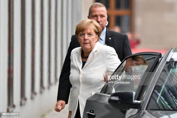 German Chancellor Angela Merkel arrives as members of the delegations of the CDU/CSU conservative alliance the liberal FDP party and the leftleaning...