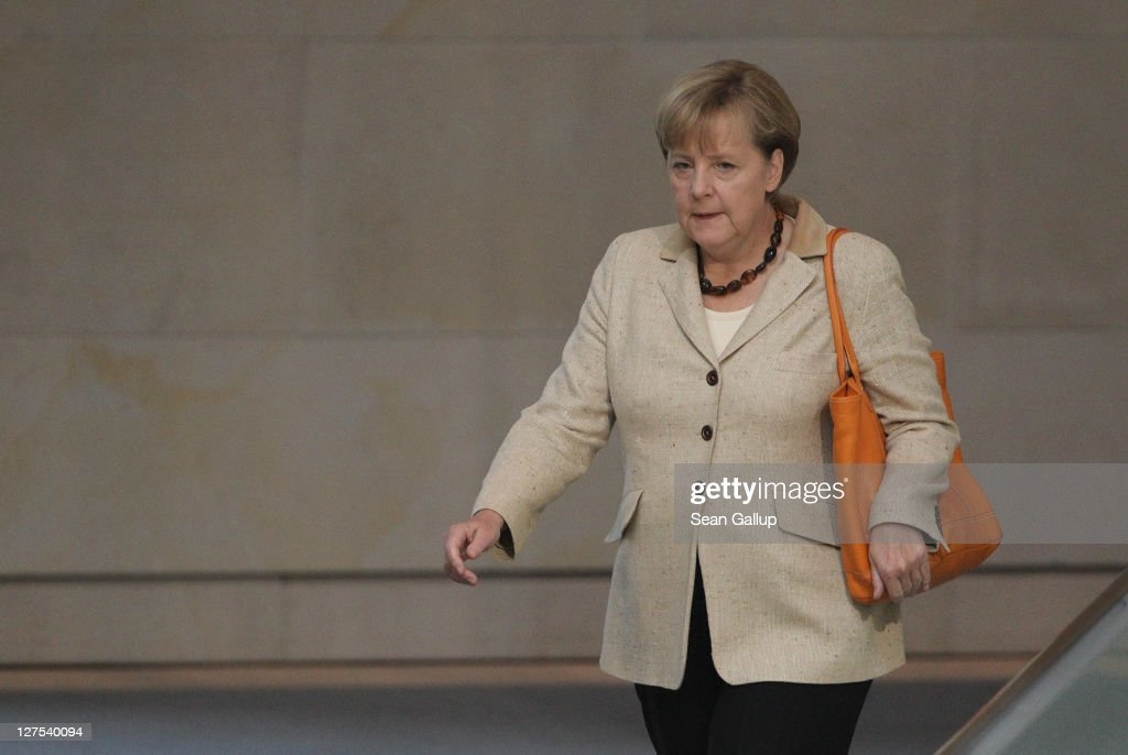 German Chancellor Angela Merkel arrives at a session of the Bundestag in which members will vote on an increase in funding for the European Financial Stability Facility (EFSF) on September 29, 2011 in Berlin, Germany. Many analysts see the increase as crucial for safeguarding the future stability of the Euro in the face of the current debt crisis in Greece. Merkel is pressing for the increase, and though opposition parties have pledged to support the bill, up to 19 dissenters within the ranks of her own coalition might vote against it.