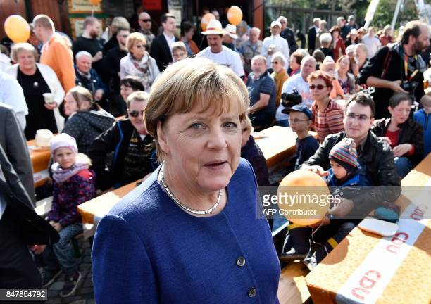German Chancellor Angela Merkel arrives at a town fair as she continued on the election campaign trail in Stralsund on September 16 a week before...