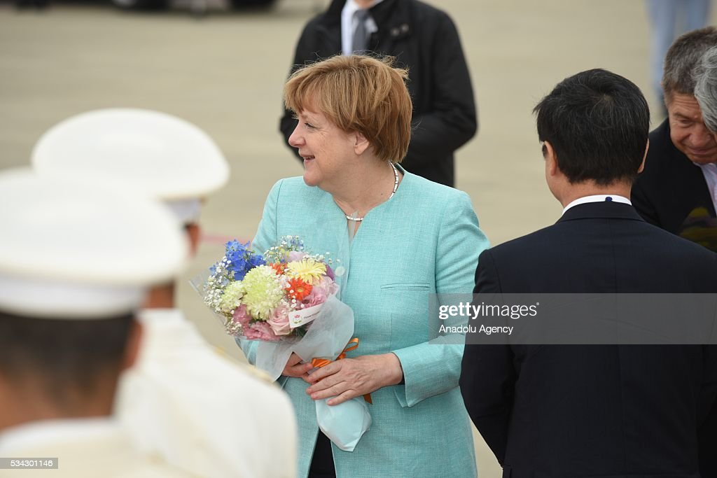 German Chancellor Angela Merkel (L-2) arrives at Chubu Centrair International Airport in Tokoname, Aichi Prefecture, central Japan, 25 May 2016.